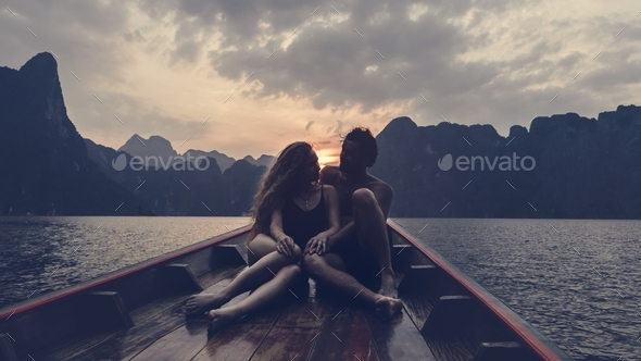 Couple boating on a quiet lake - Stock Photo - Images