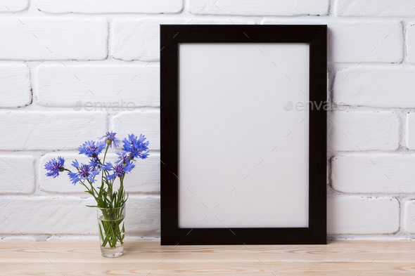 Black brown poster frame mockup with cornflower - Stock Photo - Images