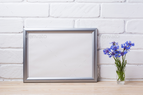 Silver landscape frame mockup with cornflower - Stock Photo - Images