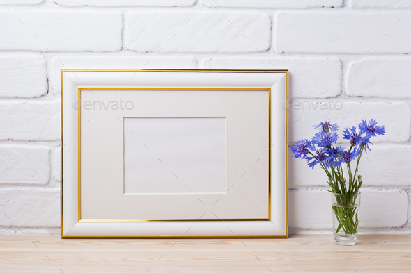 Gold decorated frame mockup with cornflower - Stock Photo - Images
