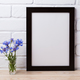 Black brown poster frame mockup with cornflower - PhotoDune Item for Sale