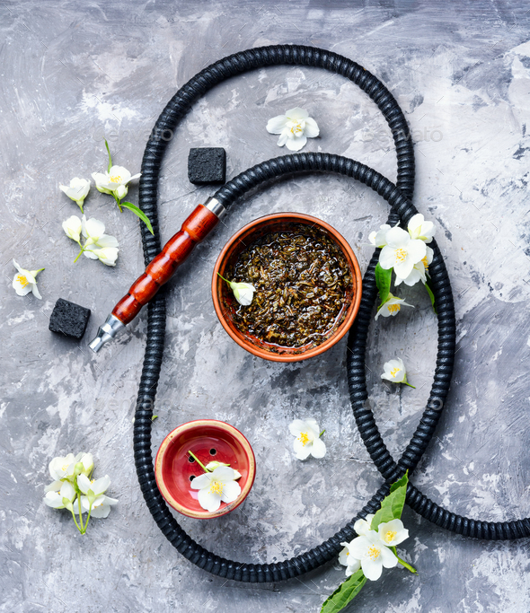 Oriental tobacco hookah with floral jasmine aroma - Stock Photo - Images