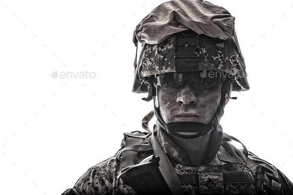 Equipped army soldier with dirty face studio shot - Stock Photo - Images