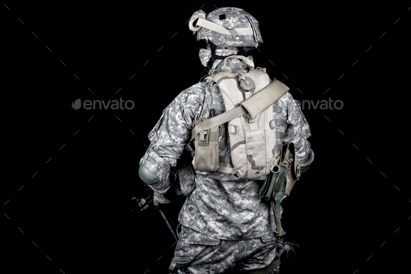 Army soldier equipped for mission in desert area - Stock Photo - Images