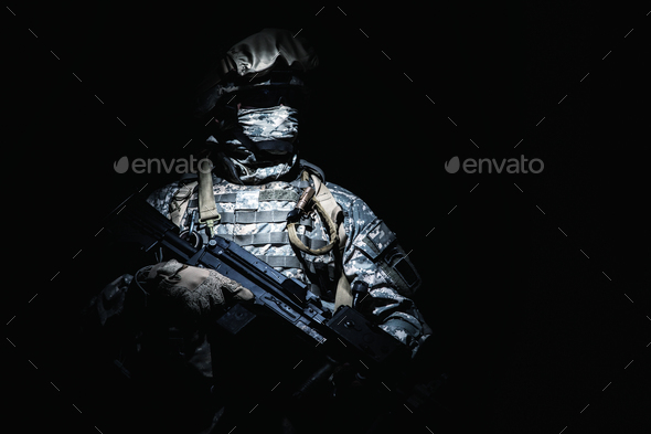 Infantry with machine gun standing in darkness - Stock Photo - Images