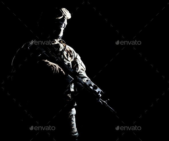Armed infantryman during night military operation - Stock Photo - Images