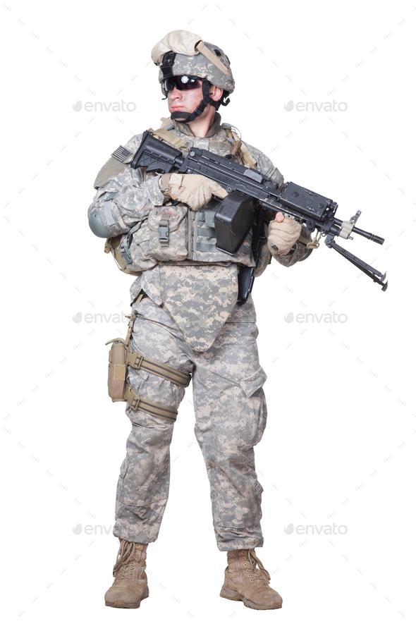 Full equipped US marine standing with machine gun - Stock Photo - Images