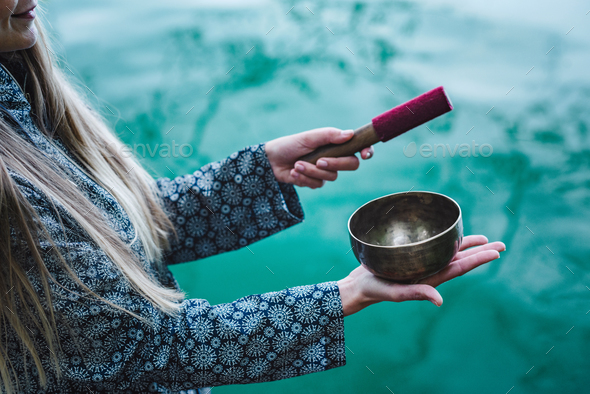 Young woman with Tibetan bowl - Stock Photo - Images
