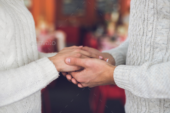 Hands of a loving couple - Stock Photo - Images