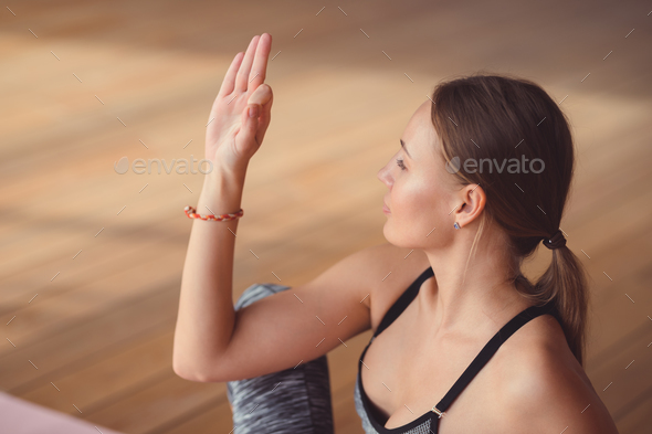 Young woman practicing yoga indoors - Stock Photo - Images