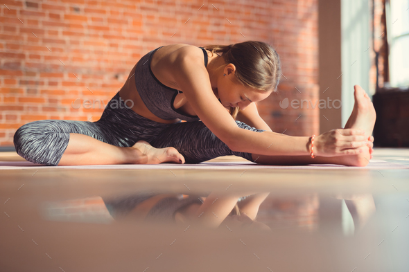 Young woman doing yoga - Stock Photo - Images
