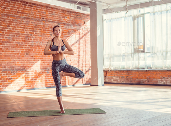 Young instructor in a yoga class - Stock Photo - Images