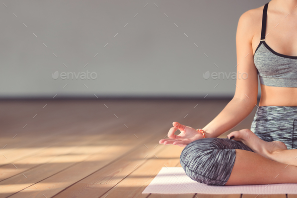 Young girl in a lotus pose - Stock Photo - Images