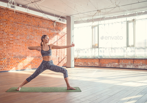 Sport girl practicing yoga - Stock Photo - Images