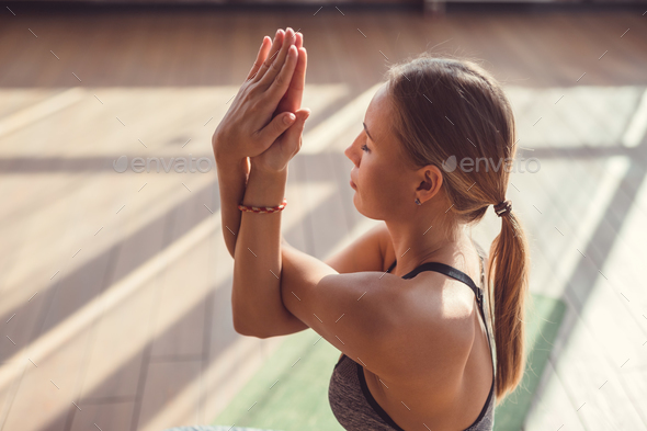 Young woman meditating indoors - Stock Photo - Images