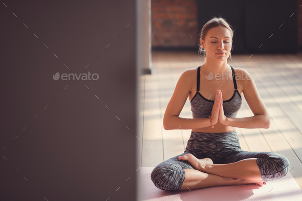 Yoga instructor in the loft - Stock Photo - Images