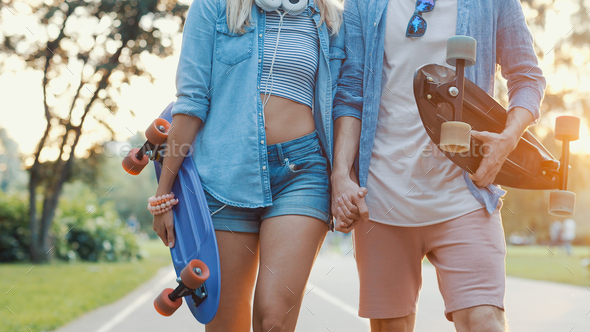 Smiling friends with skateboards - Stock Photo - Images