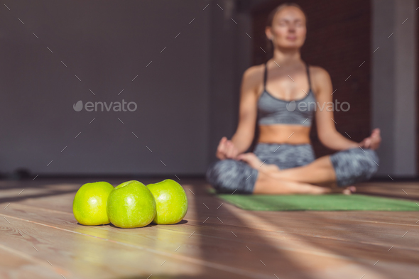 Attractive woman in a lotus pose - Stock Photo - Images