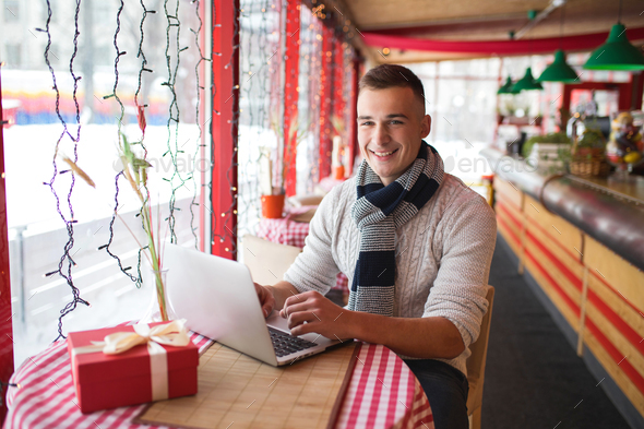 Smiling man with laptop - Stock Photo - Images
