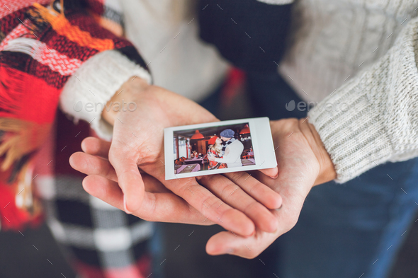 Young couple with a photo - Stock Photo - Images