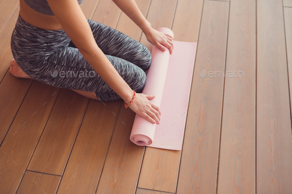 Young girl with yoga mat - Stock Photo - Images