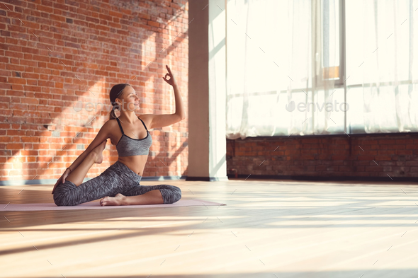 Attractive young girl practicing yoga - Stock Photo - Images