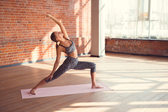 Attractive woman practicing yoga - Stock Photo - Images