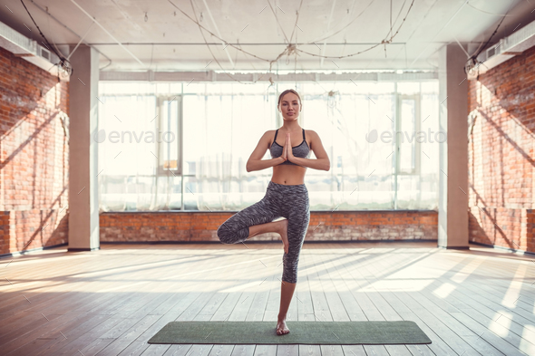 Young girl in a yoga class - Stock Photo - Images