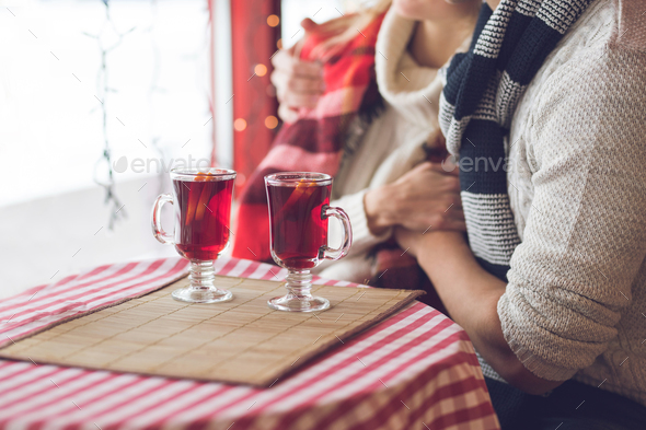 Young couple with glasses of mulled wine - Stock Photo - Images
