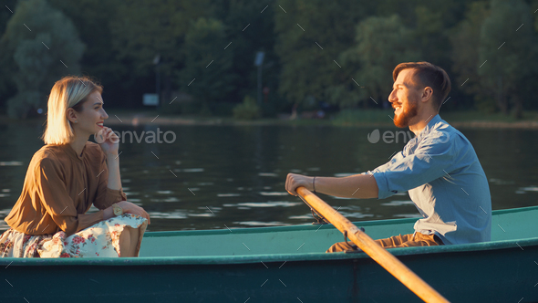 Attractive couple in a boat - Stock Photo - Images