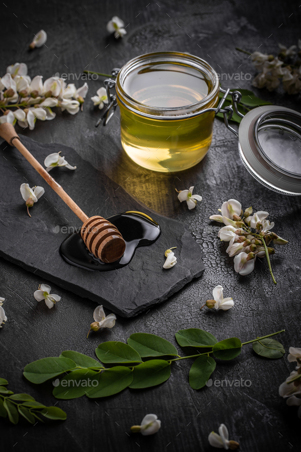Acacia flowers and natural honey - Stock Photo - Images