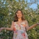 Woman Stands In A Lush Blossoms Apple Orchard And Throws Flower Petals Up - VideoHive Item for Sale