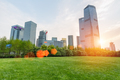 city park lawn with modern building in sunset - PhotoDune Item for Sale