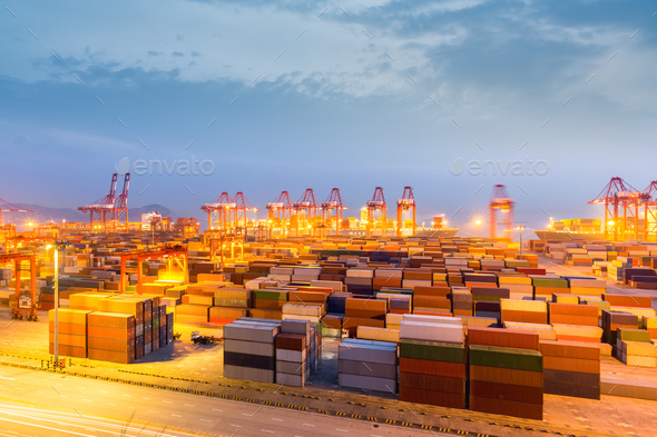 shanghai container terminal in nightfall - Stock Photo - Images