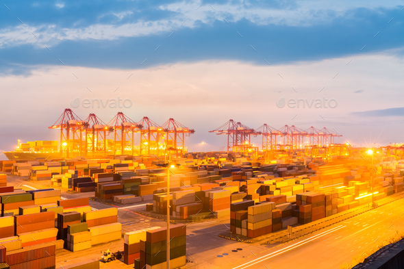 modern container terminal in nightfall - Stock Photo - Images