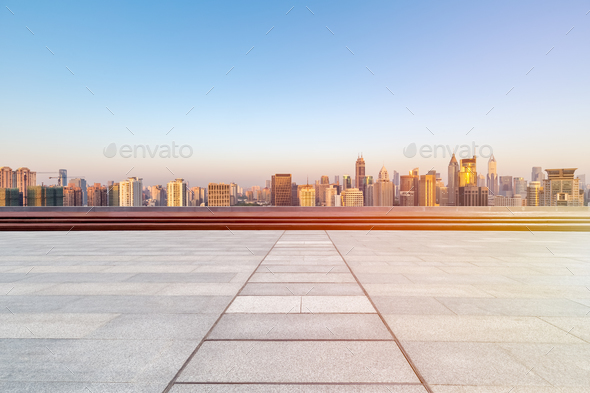 empty floor with skyline and buildings in sunrise - Stock Photo - Images