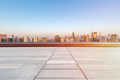 empty floor with skyline and buildings in sunrise - PhotoDune Item for Sale