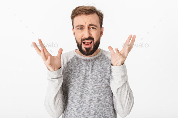 Displeased screaming young man - Stock Photo - Images