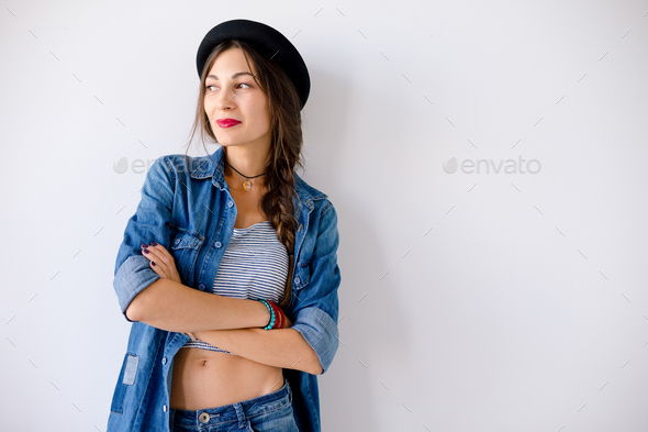 Portrait smiling young woman with hat - Stock Photo - Images
