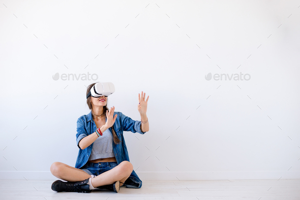 Smiling young woman use VR glasses - Stock Photo - Images