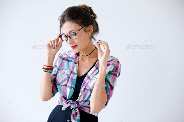 Attractive positive young woman in glasses - Stock Photo - Images