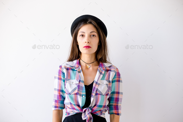Studio portrait of serious hipster girl - Stock Photo - Images