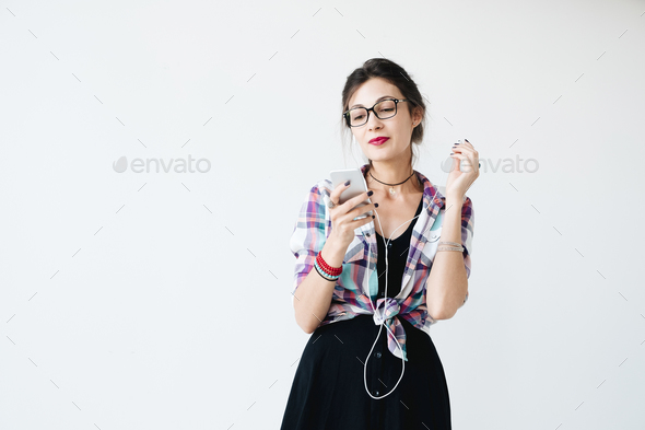 Girl putting on her earphones - Stock Photo - Images