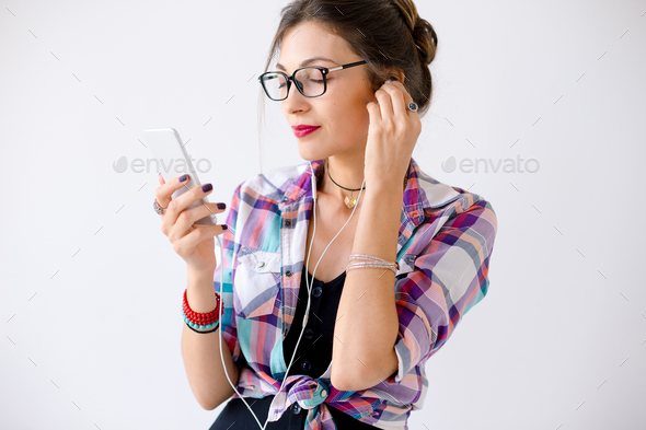 Beautiful woman in glasses enjoying music - Stock Photo - Images