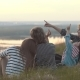 Happy Family on Vacation on the Hill as Mosquitoes Bite a Little Boy at Sunset - VideoHive Item for Sale