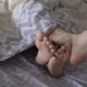 Legs of a Man and a Woman on a Bed Sticking Out From Under the Blankets - VideoHive Item for Sale