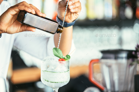 Hands of a bartender pouring alcohol - Stock Photo - Images