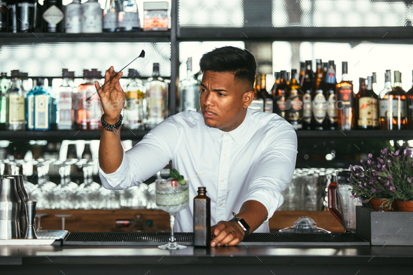 Expert bartender with cocktail bar spoon - Stock Photo - Images
