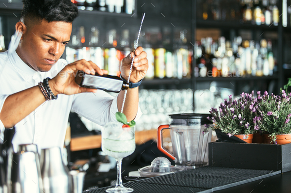 Expert bartender pouring alcohol - Stock Photo - Images