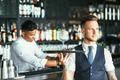 Elegant waiter serving a cocktail - PhotoDune Item for Sale
